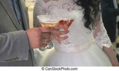 Goblets with seething wine - Unknown bride and groom holding...