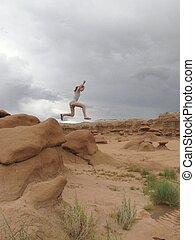 Goblin Valley Utah girl leaping
