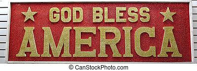 God Bless America sign written in gold glitter on a red glitter background