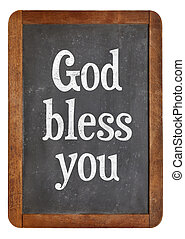 God bless you - text on a vintage slate blackboard