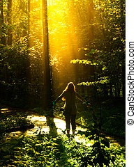 God is comming - Young woman standing in the forest and ...