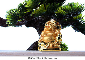 Budai or Hotei - god of riches, he is popularly known also as the Fat Buddha.