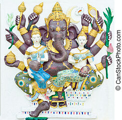 God of success 12 of 32 posture. Indian style or Hindu God Ganesha avatar image in stucco low relief technique with vivid color, Wat Samarn, Chachoengsao, Thailand.