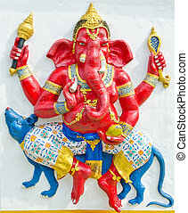 God of success 13 of 32 posture. Indian style or Hindu God Ganesha avatar image in stucco low relief technique with vivid color, Wat Samarn, Chachoengsao, Thailand.