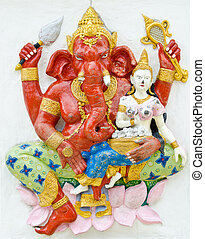 God of success 17 of 32 posture. Indian style or Hindu God Ganesha avatar image in stucco low relief technique with vivid color, Wat Samarn, Chachoengsao, Thailand.