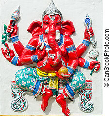 God of success 21 of 32 posture. Indian style or Hindu God Ganesha avatar image in stucco low relief technique with vivid color, Wat Samarn, Chachoengsao, Thailand.