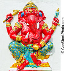 God of success 26 of 32 posture. Indian style or Hindu God Ganesha avatar image in stucco low relief technique with vivid color, Wat Samarn, Chachoengsao, Thailand.