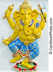God of success 31 of 32 posture. Indian style or Hindu God Ganesha avatar image in stucco low relief technique with vivid color, Wat Samarn, Chachoengsao, Thailand.