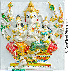 God of success 32 of 32 posture. Indian style or Hindu God Ganesha avatar image in stucco low relief technique with vivid color, Wat Samarn, Chachoengsao, Thailand.