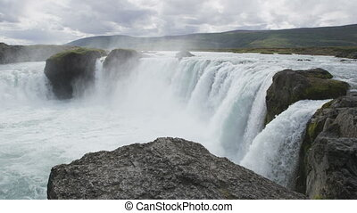 Iceland tourist attraction. Majestic view of powerful Godafoss waterfall. It is a beautiful Icelandic waterfall on the North of island. It is one of the famous tourist destination.