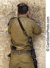 God's Soldier - A lieutenant in the Israeli army pressed in...