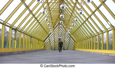 going businessman on bridge