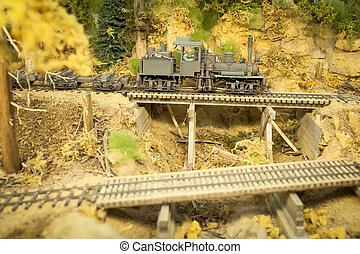 going downhill - model vintage steam locomotive on a...