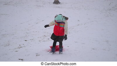 Going for a Sled Race - Little girl is walking up the hill...