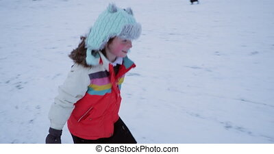 Going for a Sled Race - Little girl is walking up the hill ...