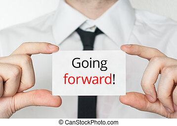 Going forward. Businessman holding business card