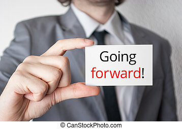 Going forward. Businessman showing business card