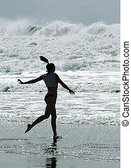 Going in - Girl running into ocean