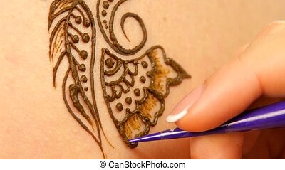 Going on of drawing process of henna mehendi ornament on...