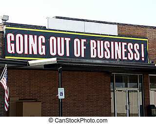 Going out of business building with sign