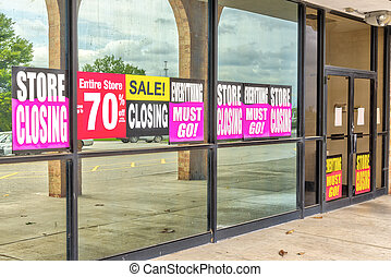 Going Out of Business Signs in Retail Store Windows