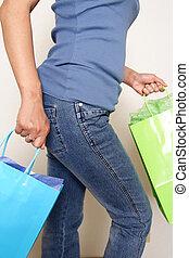 Going shopping - A woman carrying shopping bags