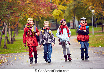 Going to school - Group of happy schoolkids going to school