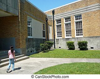 Going To School - Child walking in front of school.