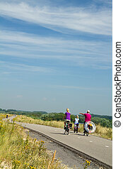 going to the beach - family cycling on a cycling track at...