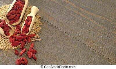 Goji berries - Background and scoop of goji berries on...
