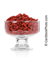 Goji berries in a glass bowl on white