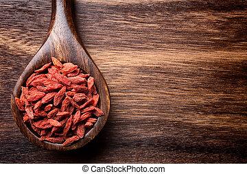 Goji berry. - Goji berries on a wooden spoons, wooden brown ...