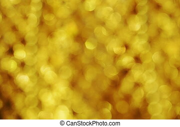 gold abstract background with blurred defocus bokeh light