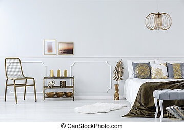 Gold accents in bedroom