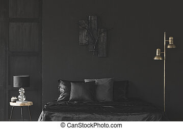 Gold and black bedroom interior