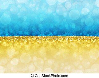gold and blue abstract bokeh lights.