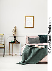 Gold and green bedroom interior