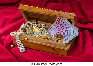 gold and jewelry - gold in coins and bars with decorations...