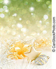 Gold and silver Christmas baubles on background of defocused golden lights