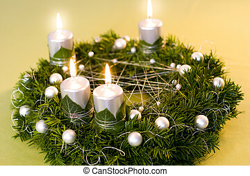 Gold and silver christmas garland on yellow background. - ...