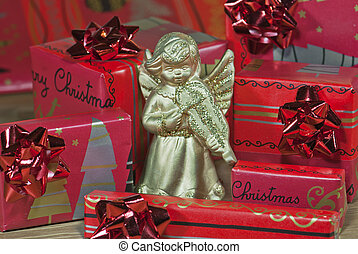Gold angel with christmas gifts