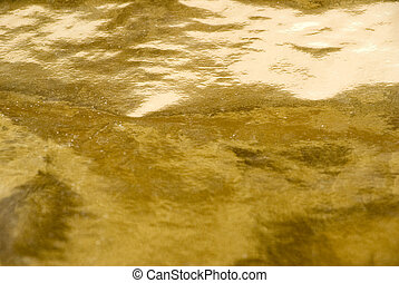 gold background texture of the rumpled paper