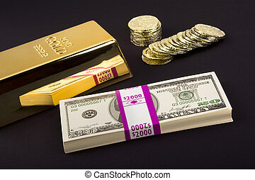 Gold bar and coins on black