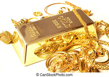 Gold Bar and Jewelry - A fine Gold Bar surrounded by...