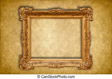 Gold baroque frame on a golden damask Victorian wallpaper
