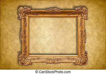 Gold baroque frame on a golden damask Victorian wallpaper