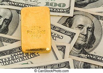 gold bars on dollar bills, symbolic photo for gold reserves,...