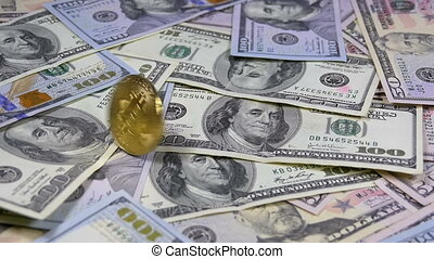 Gold Bitcoin Coin BTC Rotate, Twist, Swirling, Spinning and Falls on the Table with Dollars. Slow Motion