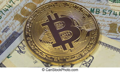 Gold Bitcoin Coin Cryptocurrency, BTC Rotate on Background with US Dollars