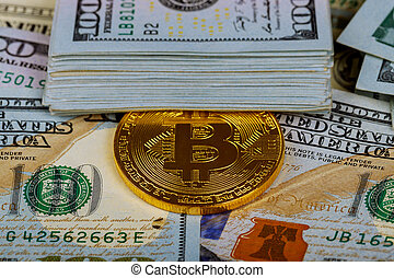 Gold bitcoin coins on one hundred US dollar bills background. Cryptocurrency, New digital currency, Bitcoin exchange to dollar money banknotes and accepted to payment,